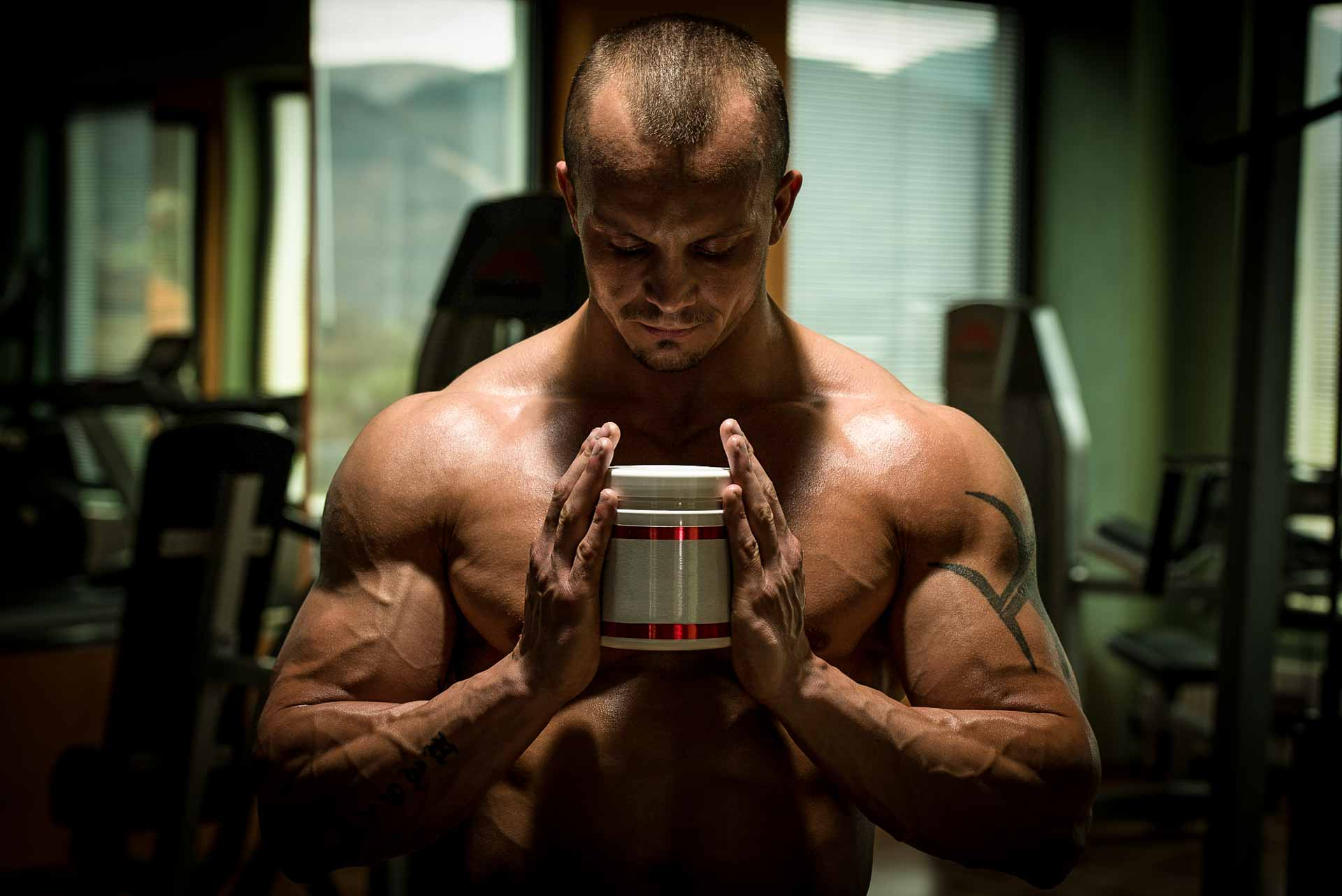 Best Steroid Alternatives man holding a jar of supplement