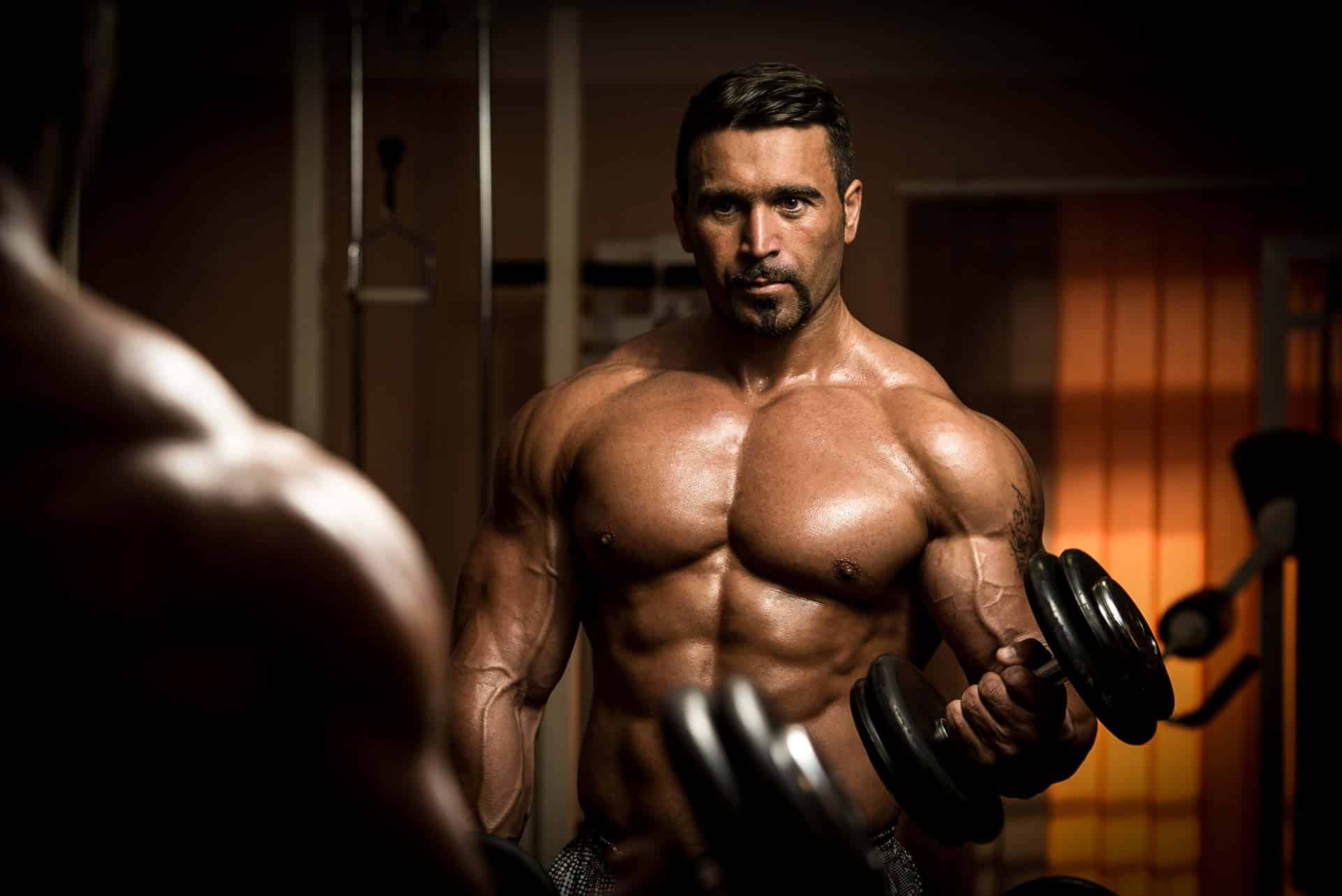 DHEA Bodybuilding man holding dumbbells