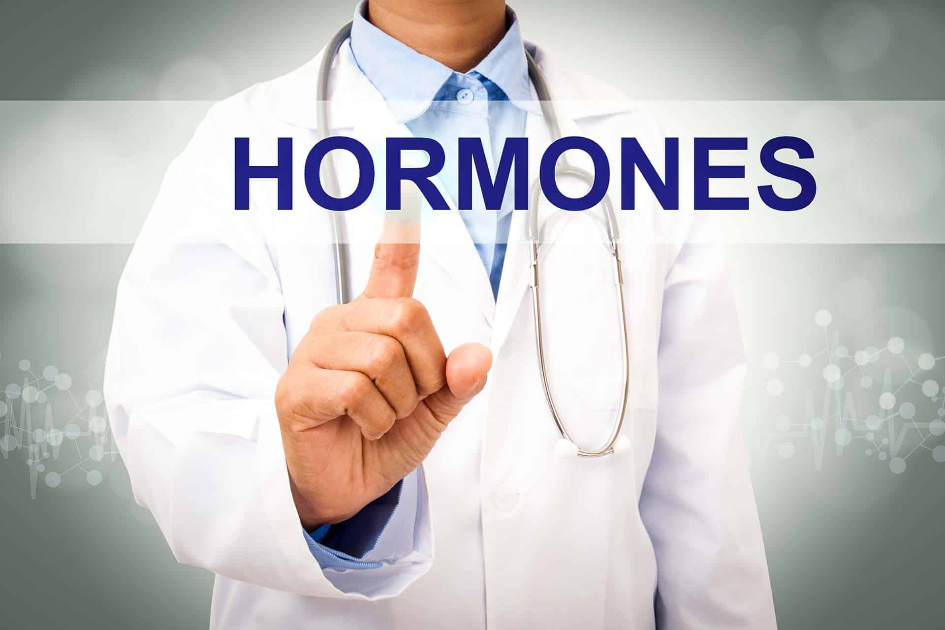 Hormone Health Test a doctor with a sign on his hand