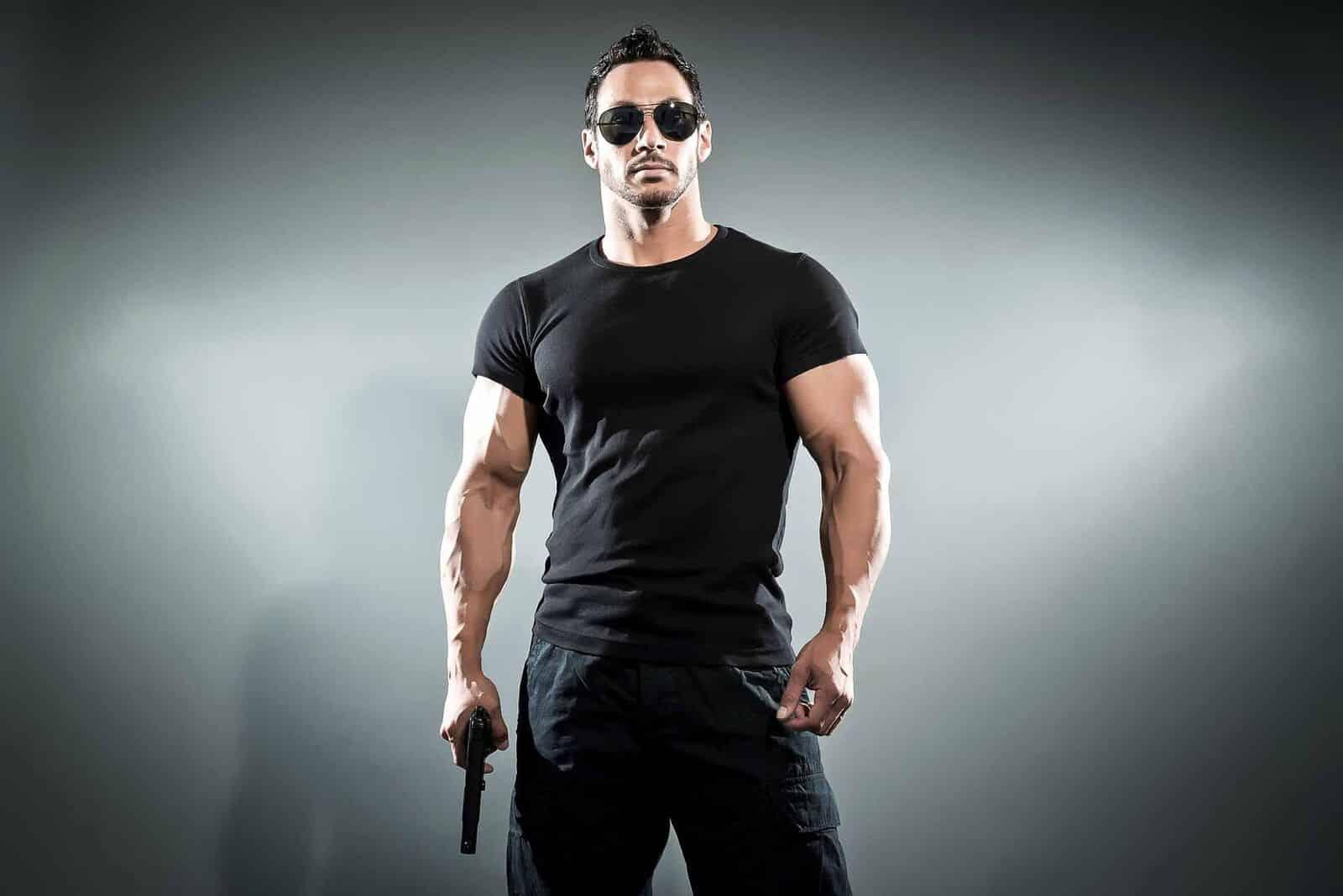 free testosterone test man holding a gun