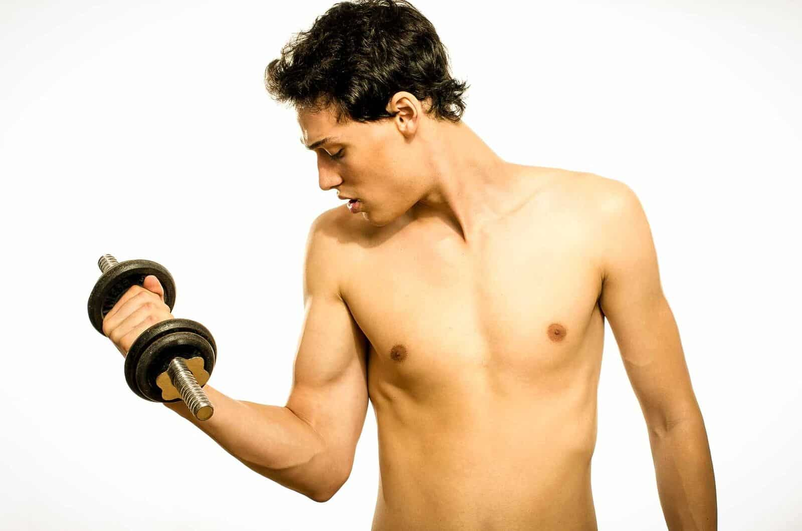 low testosterone in young men young man with dumbbells