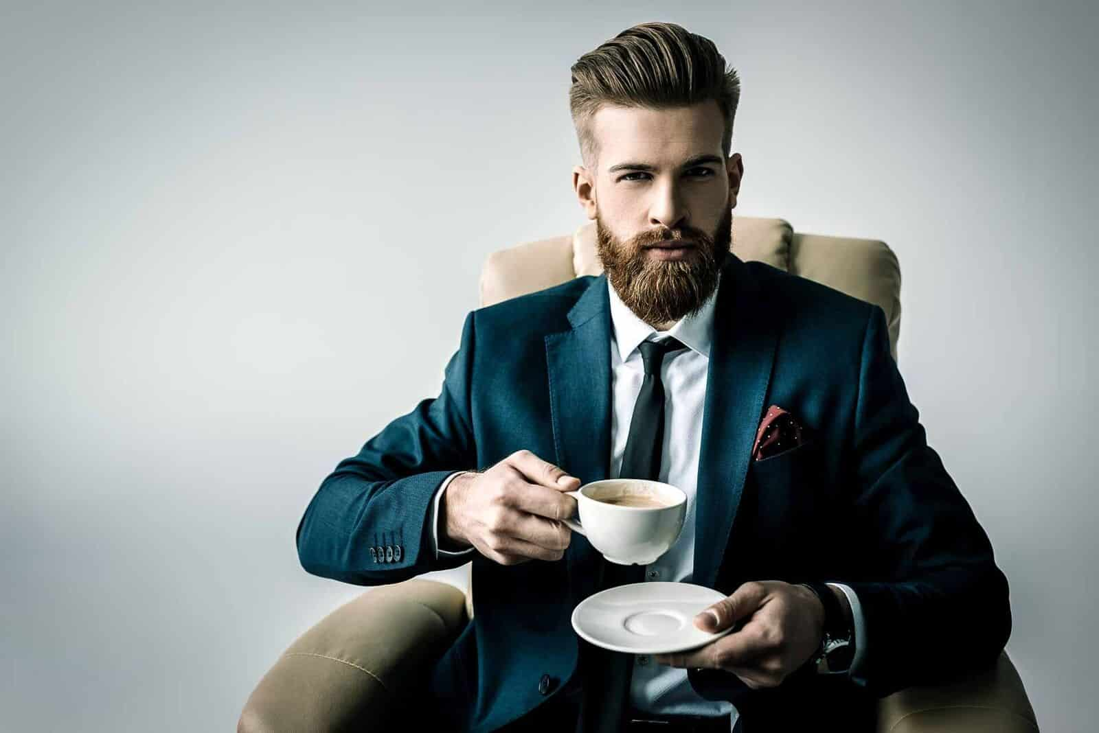 masculine men traits a decent man sitting while drinking coffee