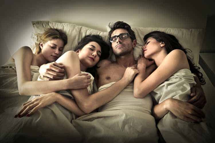 Why Is Sex So Important to Us - man in bed with girls