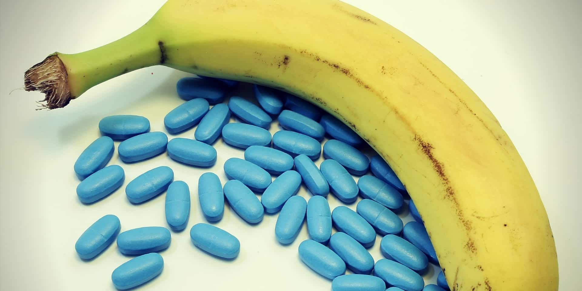 Viagra Foods banana with many blue pills for male problems