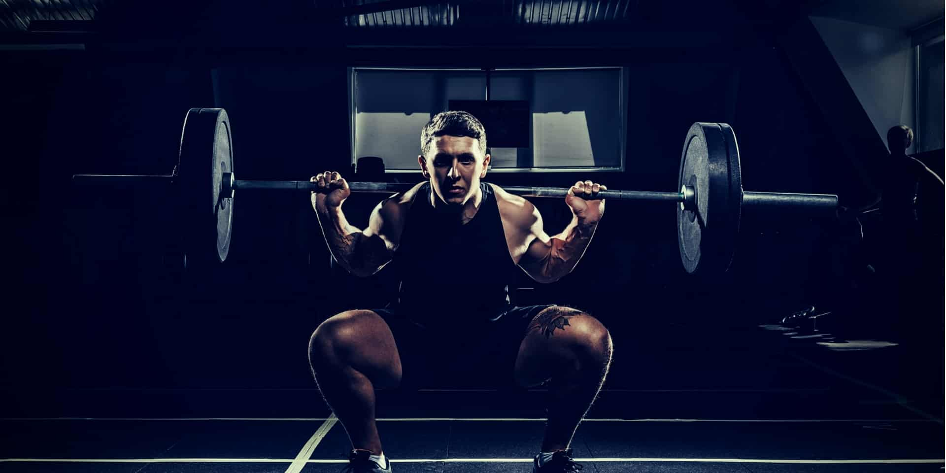 Compound Lifts or Isolation Exercises sportsman lifting a barbell