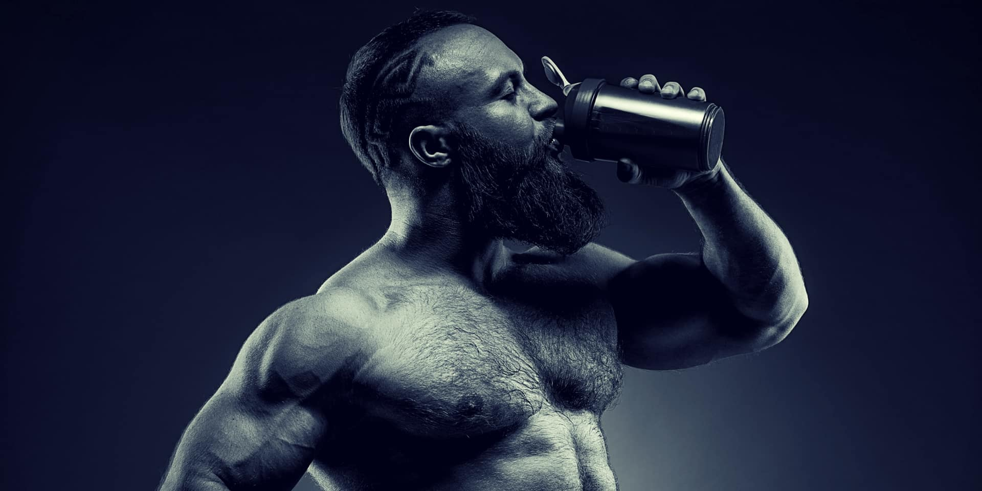 Pine Pollen Benefits bearded Man bodybuilder posing on gray background