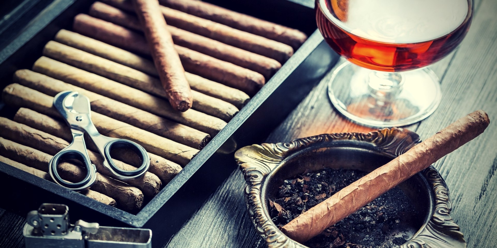 Nicotine and Testosterone Cigar in ashtray, lighter and cognac