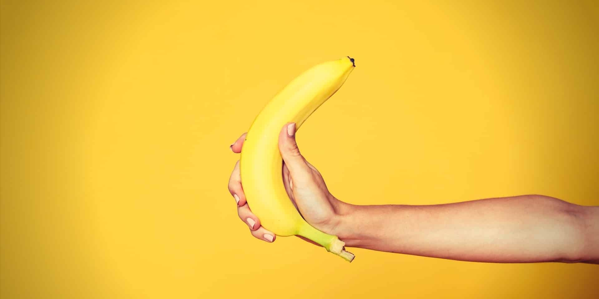 Instant Erection female hand holding banana